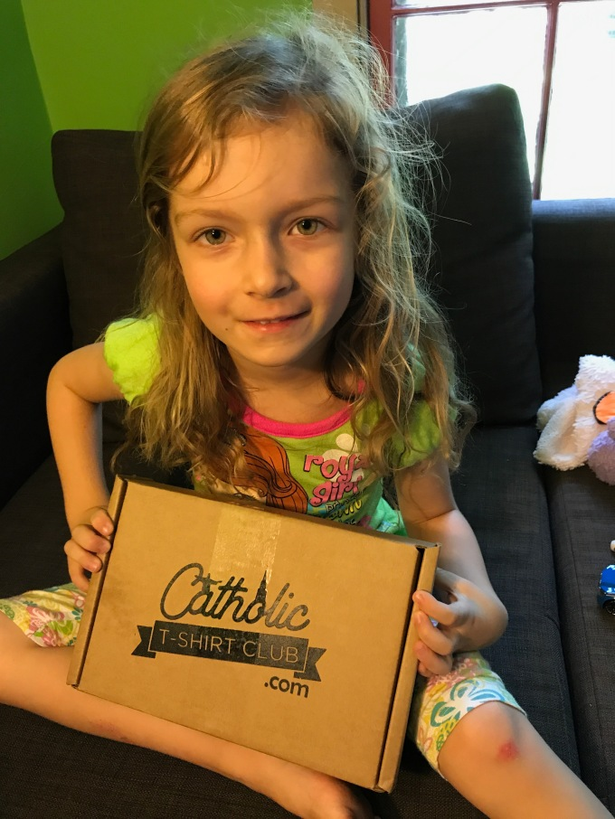 Rosie with the Catholic T-Shirt Club box